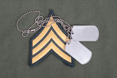 Us army uniform. Period with blank dog tags and sergeant rank patch Royalty Free Stock Images