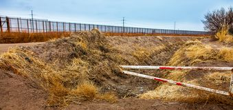 US border fence to Mexico stock photography
