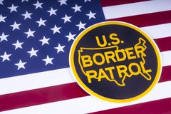 US Border Patrol. LONDON, UK - MARCH 18TH 2018: The symbol of the US Border Patrol pictured over the USA Flag, on 18th March 2018. The USBP is an American stock photo