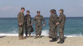 US Brigadier General John Jasen discuss with South Korean soldier. The US Brigadier General John Jasen discuss with South Korean soldiers at a beach in South stock video