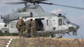 US Brigadier General John Jasen enter helicopter stock video