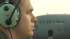 US C17 Aircraft On Airfield. A US soldier standing in front of a C17 aircraft stock video