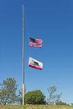 US And California Flags At Half Mast Stock Photos