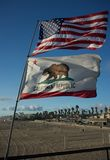 US and California state flags 2. US and California state flag fluttering in the wind at Huntington beach Stock Image