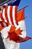 US & Canada flags. US & Canada flags on windy day Royalty Free Stock Images