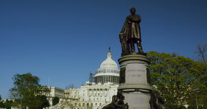 US Capital and James Garfield statue. Statue of James Garfield in front of US Capitol complex in Washington, DC stock footage