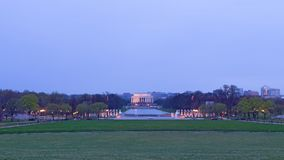 A view on World War II Memorial, reflection pool and Lincoln Memorials at dawn during cherry blossom, Washington DC, USA. US capital panorama with suburbs of Stock Photos