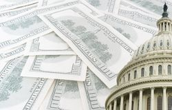 Us capitol on 100 dollars banknotes background Stock Photos