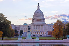 US Capitol building at autumn dawn. US Capitol building surrounded by colorful autumn trees at dawn, Washington DC Stock Photography
