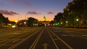 US Capitol building at dawn as seen from Pennsylvania Avenue. Colorful sunrise along Pennsylvania Avenue in Washington DC Royalty Free Stock Image