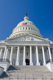 US Capitol building Entrance with US flag waves stock photography