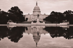 US Capitol building and mirror reflection in sepia, Washington DC, USA Stock Images