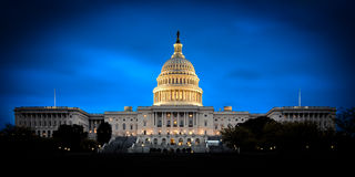 The US Capitol building at night royalty free stock image