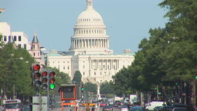 The US Capitol Building. In Washington, DC as seen from busy Pennsylvania Avenue stock footage