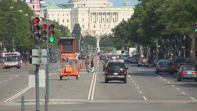 The US Capitol Building. In Washington, DC as seen from busy Pennsylvania Avenue stock video footage