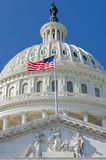 US Capitol dome detail with US flag on flagpole - royalty free stock images