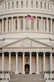 US Capitol dome detail with US flag on flagpole - Stock Photography