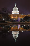 US Capitol Dome Illuminated Washington DC vertical. The dome of the US Capitol illuminated at night and mirrored in the waters of the reflecting pool in Stock Image