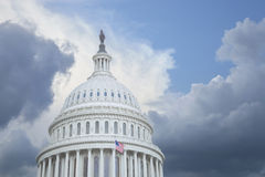 US Capitol dome under stormy skies. US Capitol dome under stormy clouds with some blue sky Stock Image