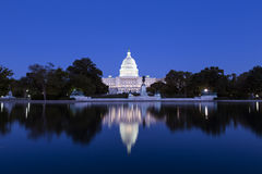 US Capitol in the dusk. Illuminated with lights reflecting in the pool Royalty Free Stock Photography