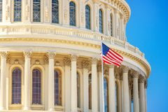 US Capitol and flag stock image
