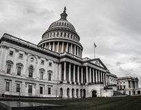 US Capitol Gloomy and Overcast. Capitol Hill sits under the cloudy sky Royalty Free Stock Photo