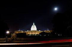 US Capitol from street in moonlight - Washington Stock Photo