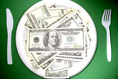 US cash on plate Royalty Free Stock Photo