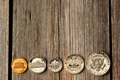 US cent coins over wooden background Royalty Free Stock Photos