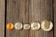 US cent coins over wooden background Stock Photos