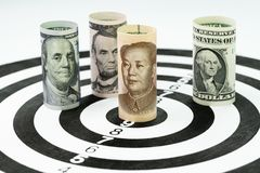 US and China financial trade war tariff strategy concept, US Dol. Lar bank roll surround and targeting Chinese Yuan bank roll at the center of dartboard Stock Photography