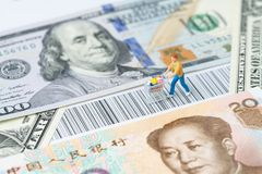 US and China trade, import or export retail ecommerce shopping c. Oncept, miniature people figurine with grocery in the shopping cart rally on the bar code with stock photography