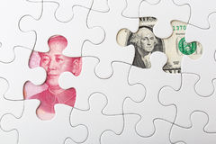 US and chinese yuan with white puzzle for exchange rate concept. Financial concept royalty free stock photo