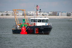 A US Coast Guard Boat deploying Buoys. Stock Images