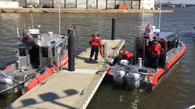 US Coast Guard boat drives in harbour stock video