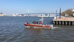 US Coast Guard boat drives out harbour stock video footage