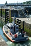 US Coast Guard boat entering Ballard Locks. Seattle, WA, USA July 9, 2017: US Coast Guard patrol boat entering Ballard Locks for transit from Puget Sound into Stock Image