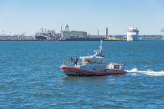 US Coast Guard boat protecting the Staten Island Ferry Stock Image