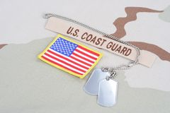 US COAST GUARD branch tape with dog tags and flag patch on desert uniform Royalty Free Stock Images