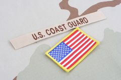 US COAST GUARD branch tape with flag on desert camouflage uniform royalty free stock image