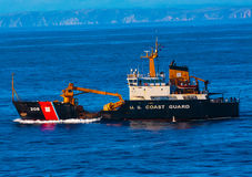 US Coast Guard Cutter Buoy Tender. San Francisco, CA, USA - May 21, 2016:  Coast Guard Cutter Buoy Tender cruising in San Francisco Bay, just west of the Golden Royalty Free Stock Photos