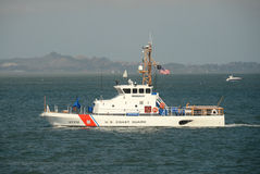 US Coast Guard cutter on patrol. San Francisco, USA - October 2, 2012: US Coast Guard cutter patrols the San Francisco Bay area ahead of the Americas Cup sailing Royalty Free Stock Photography