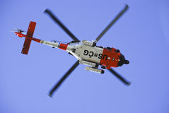 US Coast Guard Helicopter. A Coast Guard Helicopter flies over San Diego California royalty free stock photo