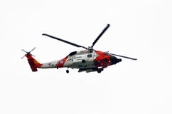 US Coast Guard Helicopter. A U.S. Coast Guard Helicopter flying in the sky. Against white background Royalty Free Stock Image