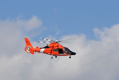 US Coast Guard helicopter departing on patrol Stock Images