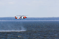 US Coast Guard helicopter training. Approaches to port of Mobie, USA – January 25, 2012: US Coast Guard Helicopter flying close to the water Stock Photo