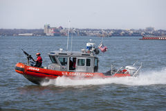 US Coast Guard. New York, March 8, 2014 – US Coast Guard boat patrolled NY harbor near Statue of Liberty Royalty Free Stock Photo