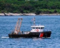 US Coast Guard patrolling Narragansett Bay, RI. The United States Coast Guard out on patrol during a parade of sail in Newport, Rhode Island royalty free stock photo