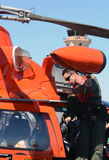 US Coast Guard pilot prepares for flight Stock Photos