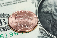 US coin and banknote. One cent. Close up Royalty Free Stock Photos